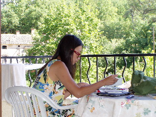Writing postcard from the balcony of our gite in Venasque